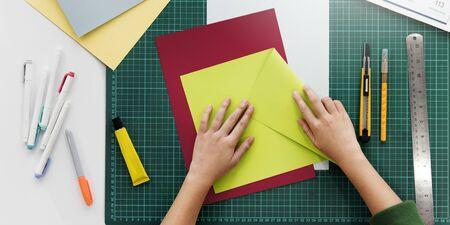 paper folding: Woman Hands Folding Paper Desk Concept Stock Photo