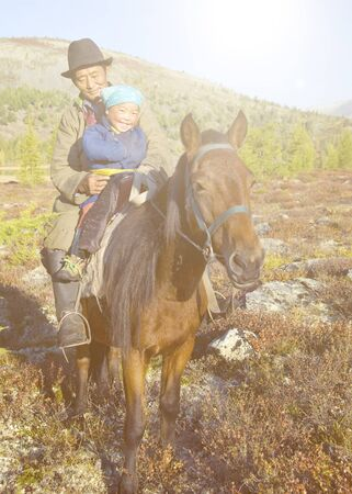 mongolian: Mongolian Tsataan on Horse Natural Concept Stock Photo