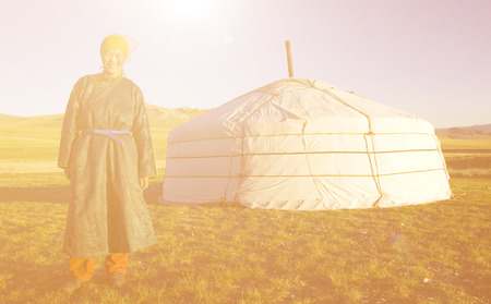mongolian: Mongolian Woman Standing In Front Of The Tent Outdoors Concept