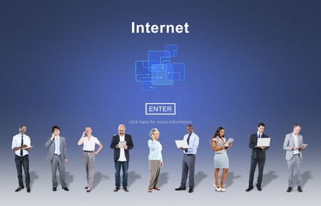 Browsing internet with multi ethnic group of people Banco de Imagens