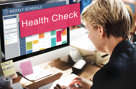 Woman scheduling for a health check Stockfoto - 109567051