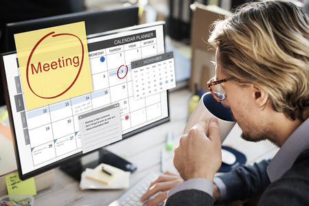 Man looking at his meeting reminder Stockfoto - 109567053