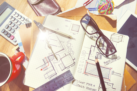 designer at work: Designers Desk with Architectural Tools and Blueprint