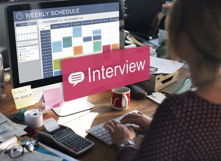 Woman scheduling for an interview Stockfoto