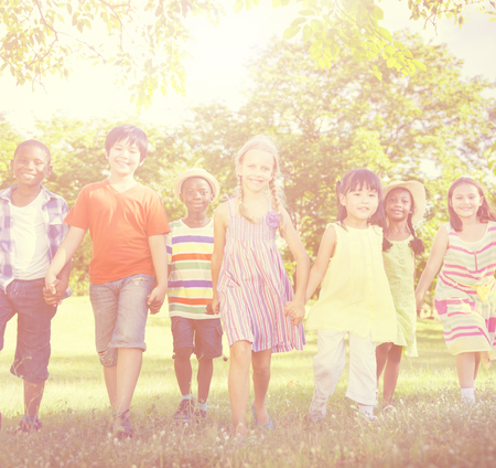 multi age: Diverse Children Friendship Playing Outdoors Concept Stock Photo