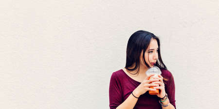 calm woman: Woman Drinking Beverage Milk Tea Drinks Waiting Concept