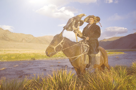 kazakh: Kazakh with Trained Eagle Concept Stock Photo