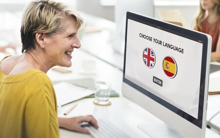 a faction: Language Dictionary English Spanish Concept Stock Photo