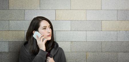 telephone call: Girl Hoodie Unhappy Phone Call Concept Stock Photo