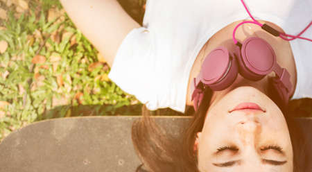 chill: Skateboard Relaxation Rest Lying Chill Headphone Concept Stock Photo
