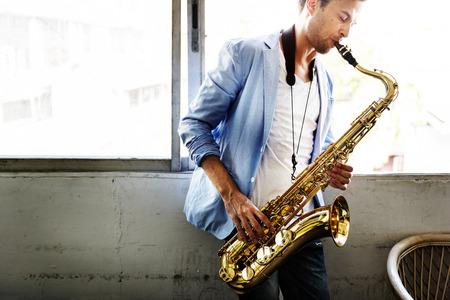 Jazzman Musical Artist Playing Saxophone Concept Imagens