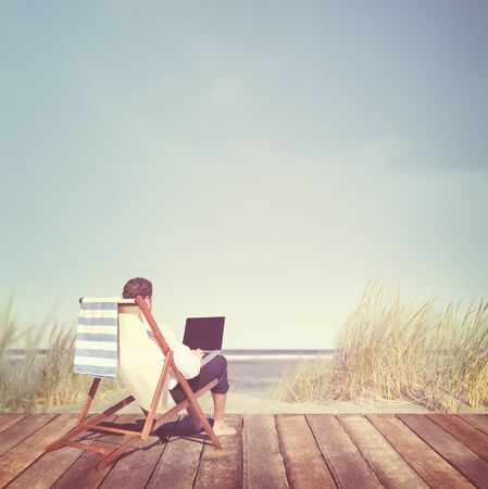 telecommuting: Businessman Working Summer Beach Relaxation Concept Stock Photo