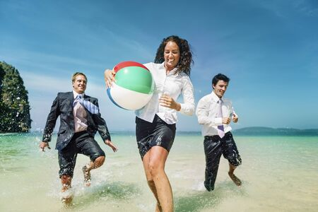 getting away from it all: Business People Fun Playing Beach Travel Concept