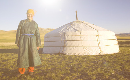 independent mongolia: Mongolian Woman Standing In Front Of The Tent Outdoors Concept