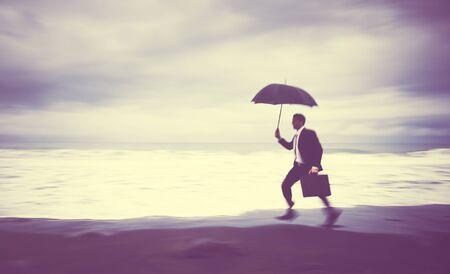 worried businessman: Worried Businessman Running Beach Concept