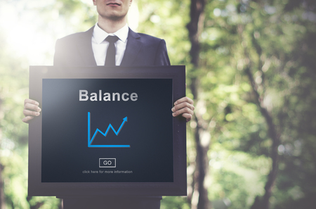 Businessman holding a frame with balance concept