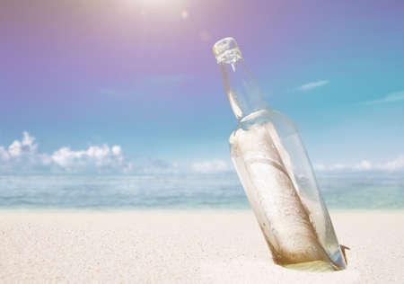 message in a bottle: Message in a bottle on beach.