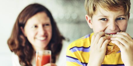 starving: Parent Child Kid Meal Juice Bread Boy Starving Concept Stock Photo