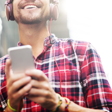 young adults: Man Walking Listening Music Earphones Concept