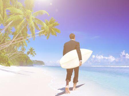 Businessman with surfboard on the beach.