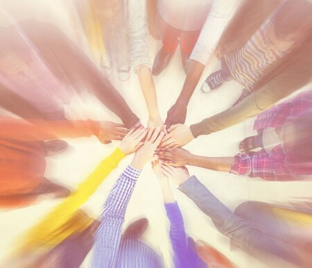 clasped: Group of People Hands Clasped Concept