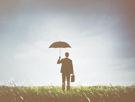 Businessman holding an umbrella Stock Photo