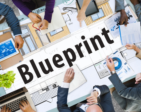 Business meeting with blueprint concept Stock Photo