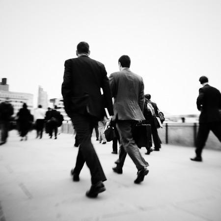 mundane: Gentlemen on their way to work.