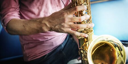 professional flute: Jazzman Musical Artist Playing Saxophone Concept Stock Photo