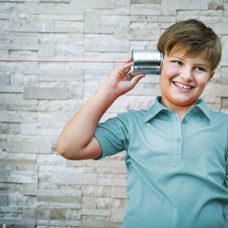 Little Boy Tin Can Phone Concept Reklamní fotografie - 58055708