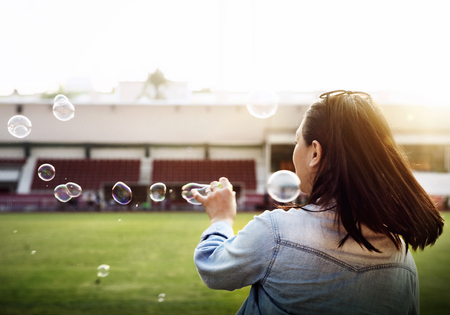 blowing bubbles: Woman Freedom Relax Blowing Bubbles Concept