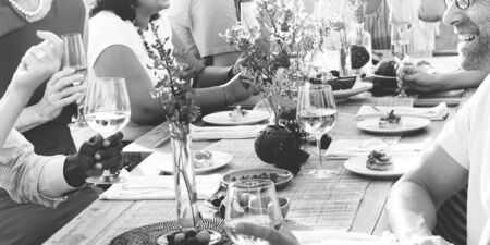 setting table: Group Diverse People Dinner Party Outdoors Concept Stock Photo