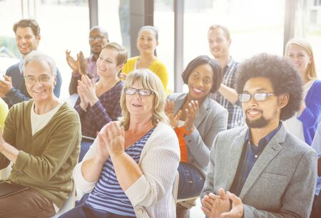 community recognition: Group of Cheerful People Clapping with Gladness Stock Photo