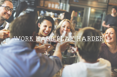 harder: Work Hard Play Harder Motto Phrase Concept Stock Photo