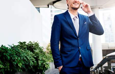 phonecall: Business Man Outdoors Phone Call Concept Stock Photo