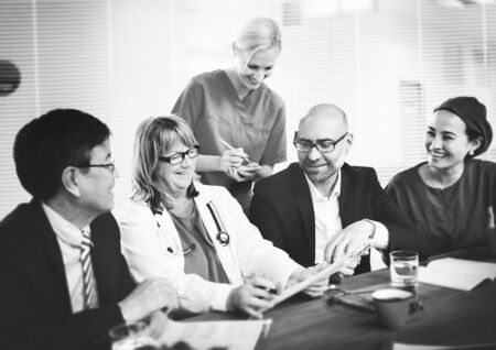 practitioners: Group of general practitioners having a meeting. Stock Photo