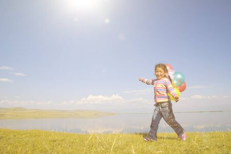 independent mongolia: Asian Girls Playing by a Lake Concept