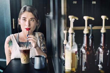 coffeeshop: Young Woman Drinking Coffee Coffeeshop Concept