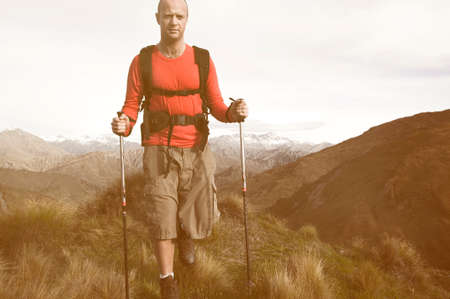 Extreme Hiking across rugged mountains, New Zealands Southern Alps. Stock Photo