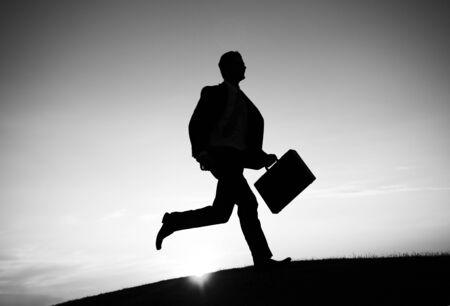 businessman running: Businessman running in the rush hour