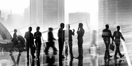 rushing hour: Back Lit Business People Cityscape Meeting Concept Stock Photo