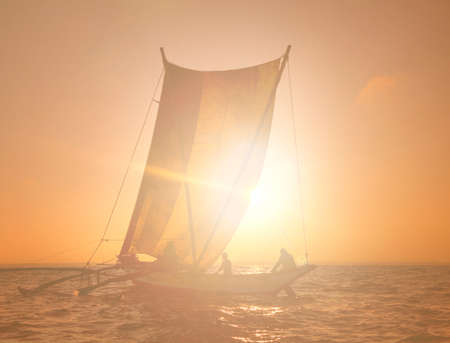 catamaran: Fishermen on a Catamaran at Sunset Concept Stock Photo