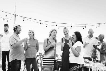 socialise: Group Diverse People Dinner Party Outdoors Concept Stock Photo