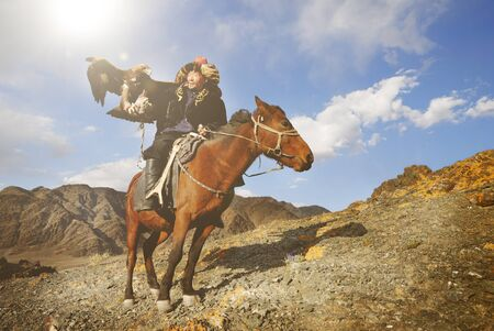 mongolian: Mongolian Man with Trained Eagle Concept