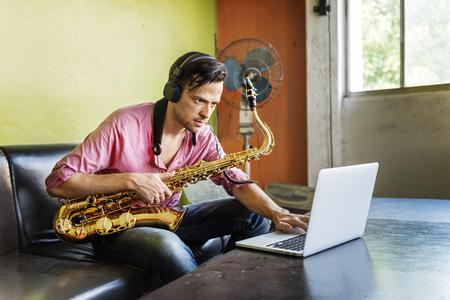Jazzman Musical Artist Playing Saxophone Concept Stock Photo