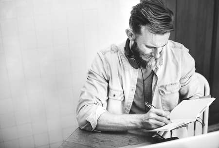 planning strategy: Man Hipster Working Writing Casual Vision Planning Strategy Concept