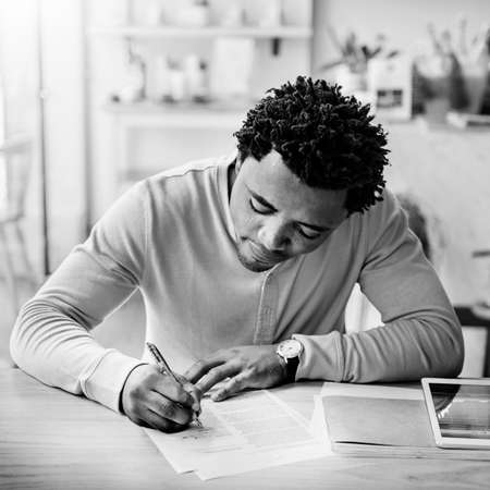 african business: African Man Writing Planning Strategy Goal Target Business Concept
