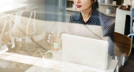 comtemporary: Casual Woman Cafe Social Media Relax Concept Stock Photo