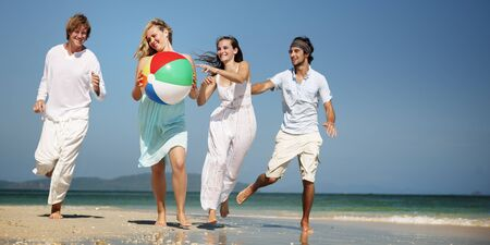 getting away from it all: People Friendship Play Beach Ball Summer Holiday Concept