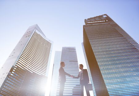 cityscape silhouette: Businessmen Cityscape Handshake Partnership Concept Stock Photo